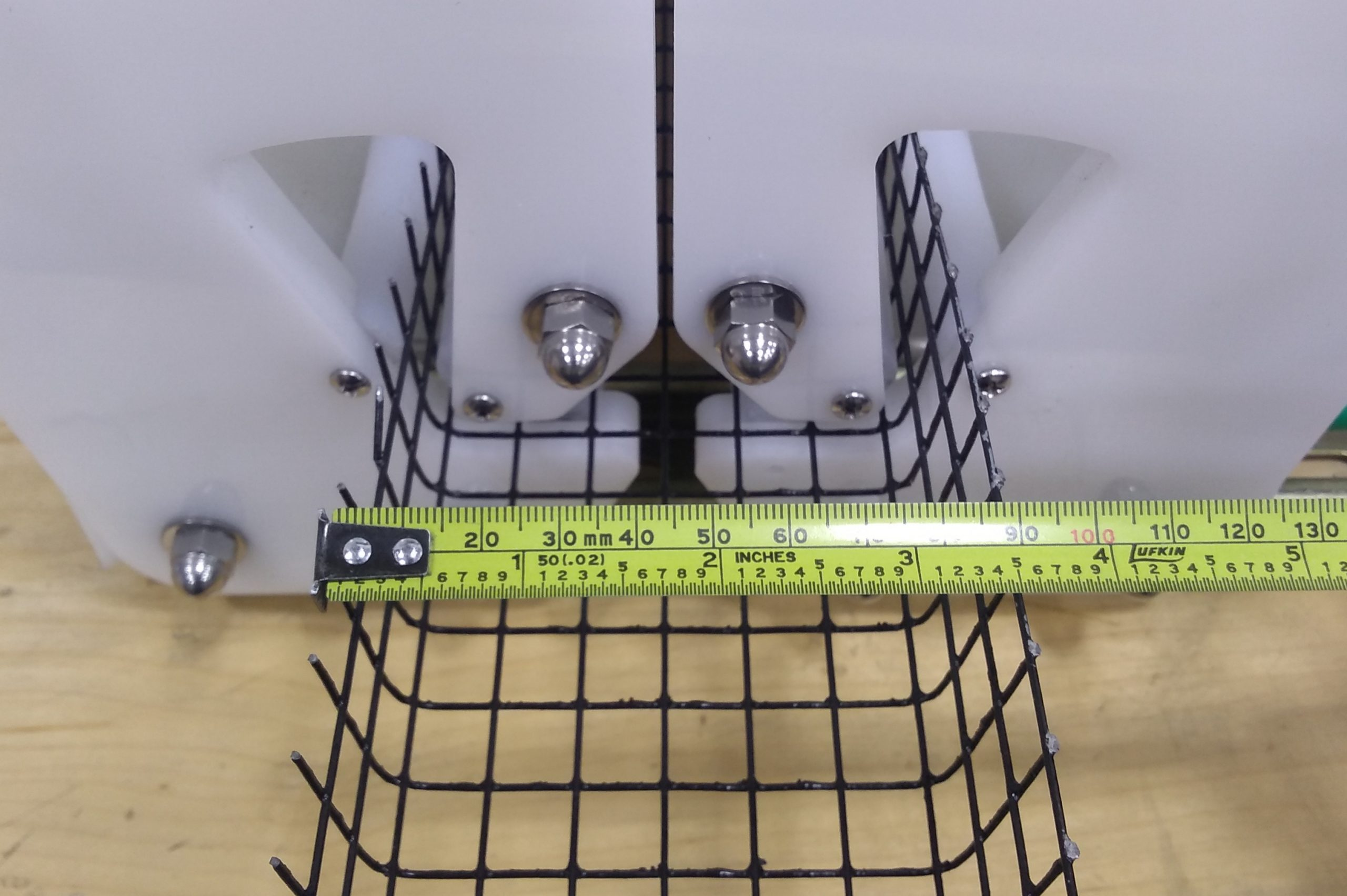 wire mesh profile with tape measure showing width